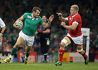 Pictured L-R: Jared Payne of Ireland brought down by Ray Barkwill of Canada Saturday 19 September 2015<br /> Re: Rugby World Cup 2015, Ireland v Canada at the Millennium, Stadium, Wales, UK