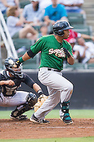 Dominic Smith (22) of the Savannah Sand Gnats follows through on his swing against the Kannapolis Intimidators at CMC-Northeast Stadium on June 9, 2014 in Kannapolis, North Carolina.  The Intimidators defeated the Sand Gnats 4-2.  (Brian Westerholt/Four Seam Images)