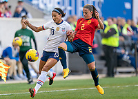 HARRISON, NJ - MARCH 08: Lynn Williams #13 of the United States fights for the ball with Ona Batlle #2 of Spain during a game between Spain and USWNT at Red Bull Arena on March 08, 2020 in Harrison, New Jersey.