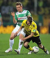 FUSSBALL   DFB POKAL   SAISON 2011/2012   HALBFINALE SpVgg Greuther Fuerth - Borussia Dortmund                  20.03.2012 Heinrich Schmidtgal (li, Greuther Fuerth) gegen Lukasz Piszczek (Borussia Dortmund)