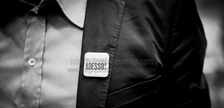 """A claim that reads """"Matteo Renzi now!"""" is seen on a pin during Matteo Renzi's political campaign convention for the Partito Democratico's primary elections -Italian left wing Party - in Turin, October 21, 2012."""