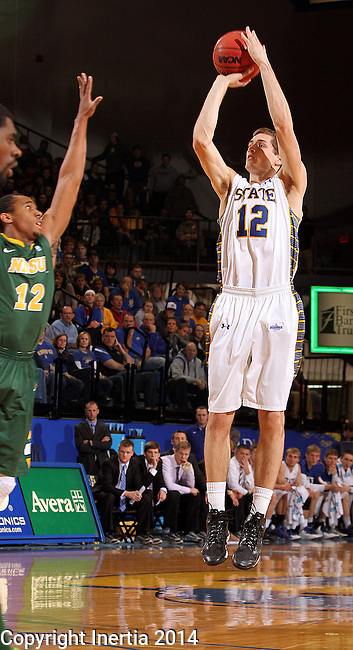 BROOKINGS, SD - JANUARY 25:  Brayden Carlson #12 from South Dakota State University spots up for a jumper over Lawrence Alexander #12 from North Dakota State University in the first half of their game Saturday afternoon at Frost Arena in Brookings. (Photo by Dave Eggen/Inertia)