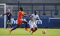 Adetayo Edun (Fulham) of England U19 battles Rodney Kongolo (Manchester City) of Holland during the International match between England U19 and Netherlands U19 at New Bucks Head, Telford, England on 1 September 2016. Photo by Andy Rowland.