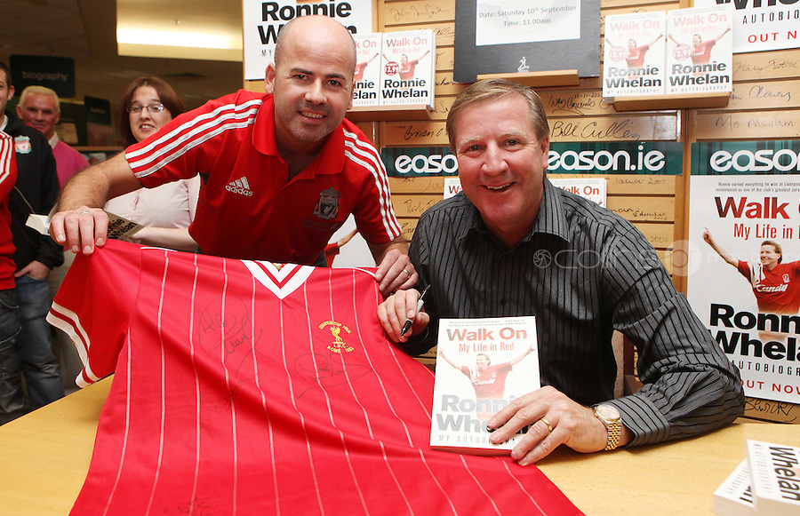 ***NO FEE PIC ***.10/09/2011.Eason Ireland's leading retailer of books , stationery, magazines & lots more hosted a book signing by former Liverpool & Irish international soccer player Ronnie Whelan..Pictured at Eason O' Connell street, Dublin is Ronnie Whelan &  Paul Moore from Finglas signing copies of his new autobiography WALK ON for fans..Follow Eason on twitter- @easons..Photo: Collins