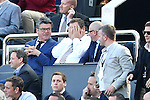 Newcastle owner Mike Ashley covers his face with his hands during the Barclays Premier League match at St James' Park. Photo credit should read: Philip Oldham/Sportimage