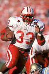 Pasadena - JANUARY 1, 1999: Running back Ron Dayne carries the ball during the 1999 Rose Bowl against the UCLA Bruins in Pasadena, California on January 1, 1999. (Photo by David Stluka)