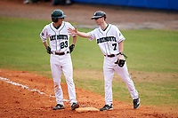 Dartmouth Big Green right fielder Matt Feinstein (23) talks with first base coach Evan Wells (7) during a game against the Lehigh Mountain Hawks on March 20, 2016 at Chain of Lakes Stadium in Winter Haven, Florida.  Dartmouth defeated Lehigh 5-4.  (Mike Janes/Four Seam Images)
