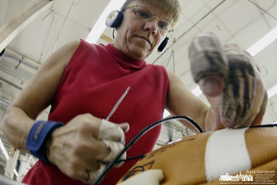 20 January 2005: Jackie Oakes laces footballs at the Wilson football factory where Super Bowl footballs are made Thursday January 20, 2005 in Ada, Ohio.<br />