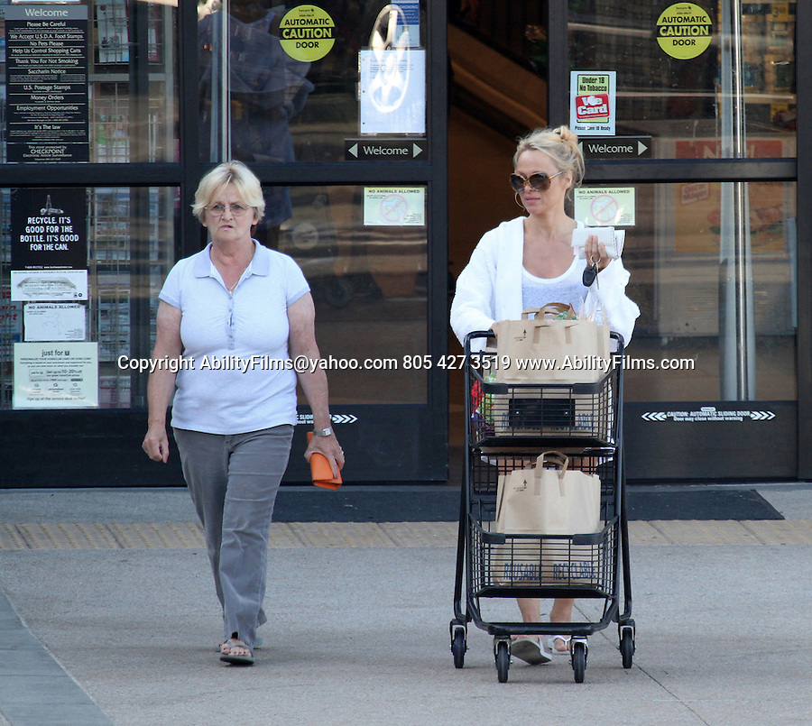 October 10th 2012   Exclusive<br /> <br /> Pamela Anderson shopping at Pavilions market with her mom Carol  in Malibu California <br /> <br /> AbilityFilms@yahoo.com<br /> 805 427 3519<br /> www.AbilityFilms.com