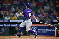 Daniel Cabrera (8) of the LSU Tigers follows through on his swing against the Baylor Bears in game five of the 2020 Shriners Hospitals for Children College Classic at Minute Maid Park on February 28, 2020 in Houston, Texas. The Bears defeated the Tigers 6-4. (Brian Westerholt/Four Seam Images)