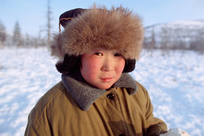 Misha Elrika, an Even boy, at reindeer herders' winter camp. Northern Evensk, Magadan Region, Eastern Siberia, Russia