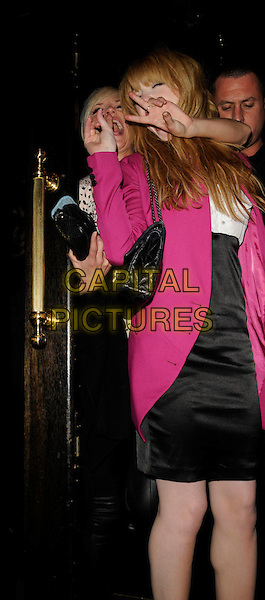 SARAH HARDING & NICOLA ROBERTS .Attends Amy Walsh's 21st Birthday Party,  The Burlington Club, London, England, March 15th 208..half length pink jacket black Chanel bag  funny tired drunk looking back hands gestures .CAP/CAN.©Can Nguyen/Capital Pictures