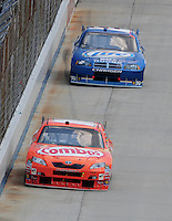 Jun 1, 2008; Dover, DE, USA; NASCAR Sprint Cup Series driver Kyle Busch (18) leads brother Kurt Busch (2) during the Best Buy 400 at the Dover International Speedway. Mandatory Credit: Mark J. Rebilas-US PRESSWIRE