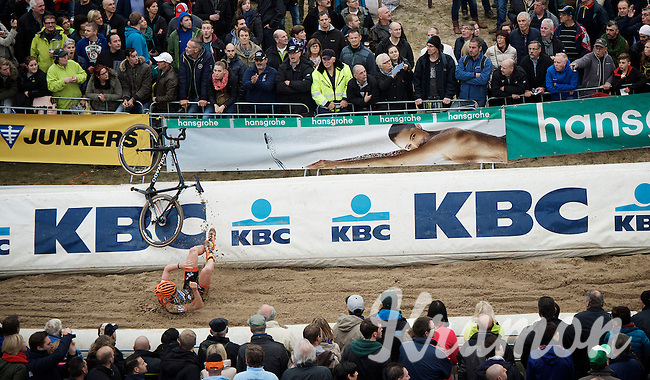 Tim Merlier (BEL/VastgoedService-Golden Palace) launching his bike over the barriers (whilst crashing at the bottom of 'The Pit')<br /> <br /> Men Elite Race<br /> Superprestige Zonhoven 2015