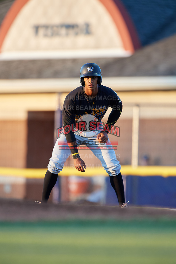 West Virginia Black Bears center fielder Sandy Santos (27) leads off first base during a game against the Batavia Muckdogs on August 5, 2017 at Dwyer Stadium in Batavia, New York.  Batavia defeated Williamsport 3-2.  (Mike Janes/Four Seam Images)