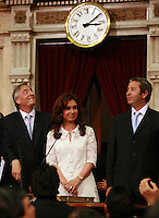Argentina new President Cristina Fernandez de Kirchner  and her husband, former president Nestor Kirchner,left,   during her inaguration at the Congress, with vicepresident Julio Cobos, right....Cristina Fernandez de Kirchner saluda durante su  asuncion en el Congreso