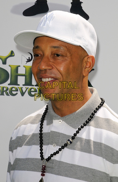 "RUSSELL SIMMONS .arriving at the Los Angeles premiere of Dreamworks Animation's ""Shrek Forever After"" at Gibson Amphitheatre in Universal City, California, .May 16th, 2010.portrait headshot white cap hat necklace striped grey gray .CAP/ROT.©Lee Roth/Capital Pictures"