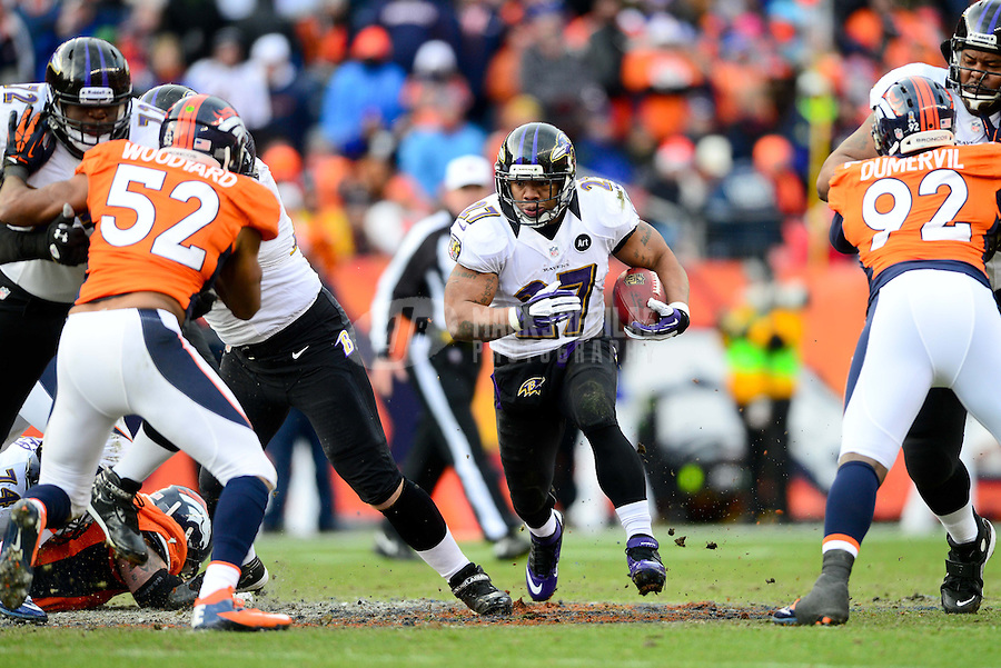 Jan 12, 2013; Denver, CO, USA; Baltimore Ravens running back Ray Rice (27) runs the ball in the first half against the Denver Broncos during the AFC divisional round playoff game at Sports Authority Field.  Mandatory Credit: Mark J. Rebilas-