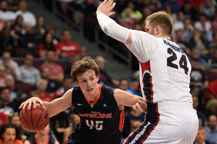 March 9, 2015; Las Vegas, NV, USA; Pepperdine Waves forward Jett Raines (45) dribbles against Gonzaga Bulldogs center Przemek Karnowski (24) during the second half of the WCC Basketball Championships at Orleans Arena.