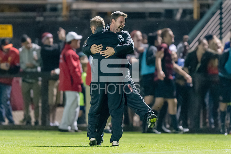 November 13, 2013: Assistant Coaches Mike Graczyk and  John Smith celebrate after the Stanford vs Cal men's soccer match in Stanford, California.  Stanford won 2-1 in overtime.