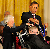 Washington, DC - August 12, 2009 -- United States President Barack Obama prepares to award Stephen Hawking, the internationally-recognized theoretical physicist the 2009 Medal of Freedom, America's highest civilian award, in the East Room of the White House in Washington, DC, USA August 12, 2009.     .Credit: Mike Theiler - CNP
