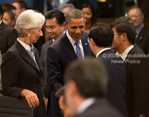 United States President Barack Obama greets China President Hu Jintao with International Monetary Fund Chief Christine Lagarde at the Opening plenary session of the Asia-Pacific Economic Cooperation (APEC) summit at the J.W. Marriott Hotel in Honolulu, Hawaii on Sunday, November 13, 2011..Credit: Kent Nishimura / Pool via CNP