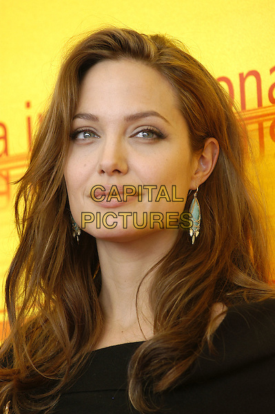 ANGELINA JOLIE.Photocall for Shark Tale, Venice Film Festival, September 10th 2004..portrait headshot.Ref: KRA.www.capitalpictures.com.sales@capitalpictures.com.©Capital Pictures.