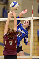 NWA Democrat-Gazette/BEN GOFF @NWABENGOFF<br /> Hannah Martin (11) of Rogers spikes the ball as Chloe Price (4) of Siloam Springs jumps to block on Thursday Aug. 27, 2015 during the match at Rogers High.