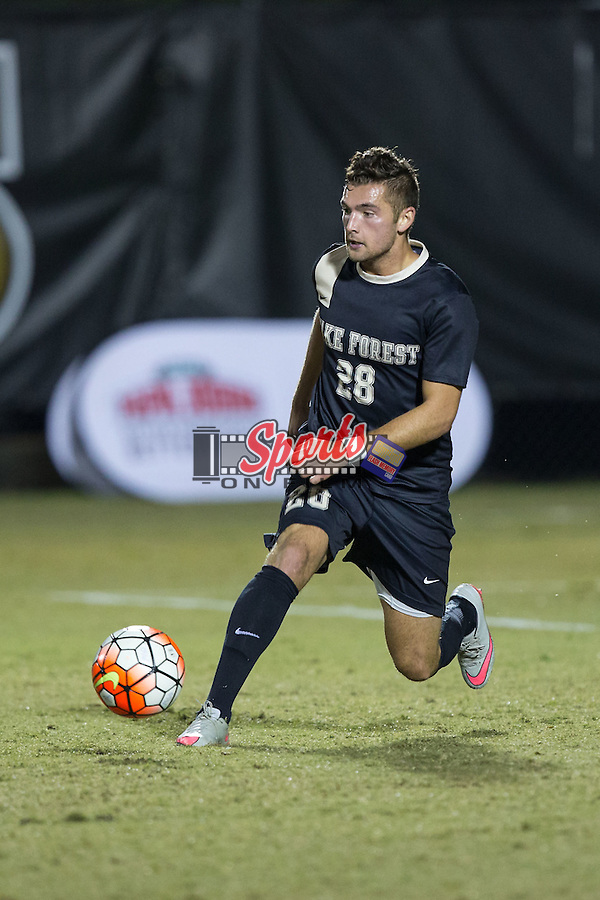 Tane Gent (28) of the Wake Forest Demon Deacons controls the ball during second half action against the Georgia State Panthers at Spry Soccer Stadium on October 20, 2015 in Winston-Salem, North Carolina.  The Demon Deacons defeated the Panthers 5-0.  (Brian Westerholt/Sports On Film)