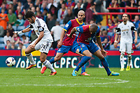 Sun 22 September 2013<br /> <br /> Pictured: Alejandro Pozuelo of Swansea gets the ball past the palace defence<br /> <br /> Re: Barclays Premier League Crystal Palace FC  v Swansea City FC  at Selhurst Park, London