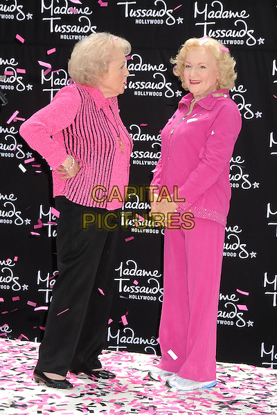 Betty White & Wax Figure.Madame Tussauds Hollywood Unveils Betty White Wax Figure held at Madame Tussauds Hollywood, Hollywood, California, USA..June 4th, 2012.full length black trousers pink top striped stripes confetti hands on hips side profile .CAP/ADM/BP.©Byron Purvis/AdMedia/Capital Pictures.