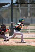 Oakland Athletics third baseman William Toffey (53) follows through on his swing during an Extended Spring Training game against the San Francisco Giants Orange at the Lew Wolff Training Complex on May 29, 2018 in Mesa, Arizona. (Zachary Lucy/Four Seam Images)