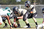 Palos Verdes, CA 10/25/13 - Jake Rathbun (Peninsula #51) and Ian Escutia (Peninsula #2) in action during the Mira Costa vs Peninsula varsity football game at Palos Verdes Peninsula High School.