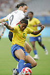 18 August 2008: Renata Costa (BRA) (5) plays the ball away from Birgit Prinz (GER) (9).  The women's Olympic soccer team of Brazil defeated the women's Olympic soccer team of Germany 4-1 at Shanghai Stadium in Shanghai, China in a Semifinal match in the Women's Olympic Football competition.