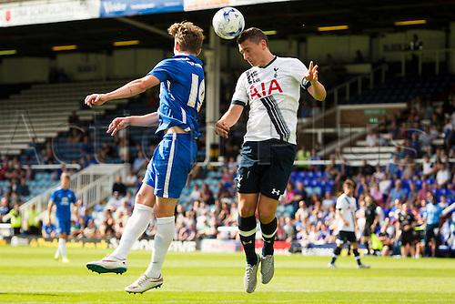 18.07.2015.  Peterborough, Engand. Pre Season Friendly Peterborough United versus Tottenham Hotspur. Dominic Ball (Tottenham Hotspur) heads the ball clear at a corner.