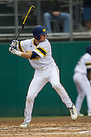 Michigan Wolverines second baseman Ramsey Romano (4) at bat during the NCAA baseball game against the Washington Huskies on February 16, 2014 at Bobcat Ballpark in San Marcos, Texas. The game went eight innings, before travel curfew ended the contest in a 7-7 tie. (Andrew Woolley/Four Seam Images)