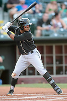 Omaha Storm Chasers second baseman Christian Colon (4) at bat during the Pacific Coast League game against the Oklahoma City RedHawks at Chickashaw Bricktown Ballpark on June 23, 2013 in Oklahoma City ,Oklahoma.  (William Purnell/Four Seam Images)