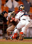 29 June 2005: Brian Schneider, catcher for the Washington Nationals, tags Rob Mackowiak out at the plate during a game against the Pittsburgh Pirates. The Nationals rallied to defeat the Pirates 3-2 in a rain delayed game at RFK Stadium in Washington, DC.  Mandatory Photo Credit: Ed Wolfstein