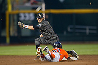 Vanderbilt Commodores shortstop Dansby Swanson (7) prepares to tag Cal State Fullerton Titans baserunner Josh Vargas (40) slides into second during the NCAA College baseball World Series on June 14, 2015 at TD Ameritrade Park in Omaha, Nebraska. The Titans were leading 3-0 in the bottom of the sixth inning when the game was suspended by rain. (Andrew Woolley/Four Seam Images)