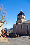 The Wine Route in early spring in Beaujolais, France. Vauxrenard, a small village, offers a well marked walking trail through the surrounding vineyards.  The church in the village where people gather at the beginning of the tour.