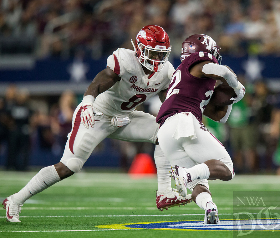 Hawgs Illustrated/Ben Goff<br /> De'Jon Harris, Arkansas linebacker, tackles Kwame Etwi,  Texas A&M tailback, in the 4th quarter Saturday, Sept. 29, 2018, during the Southwest Classic at AT&T Stadium in Arlington, Texas.