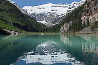 Victoria glacier reflects in the calm surface of Lake Louise, Banff National Park