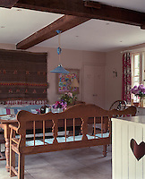 In the kitchen a pair of long benches flanks the generously proportioned pine table