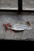 An old label left on a stone window sill