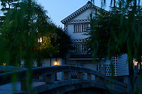 Bridge over the river Takahashi at dusk, Kurashiki, Okayama Prefecture, Japan, July 11, 2013. The historic city of Kurashiki is popular with tourists for its fine Edo Period(1603-1868) and Meiji Period (1868-1912) architecture.