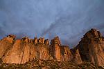 Storm clouds over cliffs in dry puna, Abra Granada, Andes, northwestern Argentina