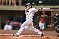 Greenville Astros catcher Brett Clements #6 swings at a pitch during a game against the Pulaski Mariners at Pioneer Park July 12, 2014 in Greenville, Tennessee. The Mariners defeated the Astros 11-10. (Tony Farlow/Four Seam Images)