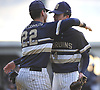 Stephen Strategakos #22 of Baldwin, left, gives starting pitcher Mike Ahearne #14 a congratulatory embraces after exiting the game in the bottom of the seventh inning of Nassau County varsity baseball game against host Plainview JFK High School on Monday, May 8, 2017. Ahearne went 6 2/3 innings and was the winning pitcher of record in Baldwin's 8-3 victory.