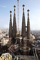 Bell towers, Passion façade, completed late 1980?s by the sculptor Josep Maria Subirachs, La Sagrada Familia, Roman Catholic basilica, Barcelona, Catalonia, Spain, built by Antoni Gaudí (Reus 1852 ? Barcelona 1926) from 1883 to his death. Still incomplete. Picture by Manuel Cohen