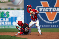 Auburn Doubledays second baseman Dalton Dulin (4) throws to first as Yuniel Ramirez (43) slides into second during a game against the Batavia Muckdogs on September 7, 2015 at Falcon Park in Auburn, New York.  Auburn defeated Batavia 11-10 in ten innings.  (Mike Janes/Four Seam Images)